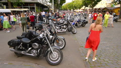 Parked Harley style black motor cycles on pedestrian zone, time lapse, Odessa Stock Footage