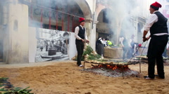 Calsot cooked on open fire during Calсotada in Valls Stock Footage