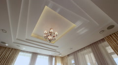 Beautiful crystal chandelier on the ceiling. Stock Footage