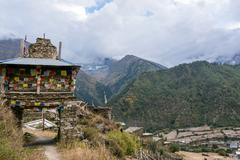 Colorful ornate buddhist stupa. Traditional village entrance in Nepal. Stock Photos