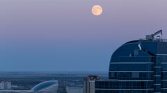 Nazarbayev Center and blue tower, after Sunset with full moon rising. Astana Stock Footage