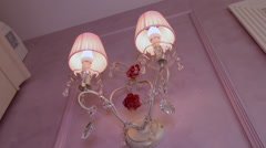 Chandelier in the form of candles on the wall. - stock footage