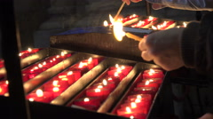 Lighting prayer candles in church. Close up Stock Footage