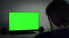 Night Time Man Watching TV Green Screen Stock Footage