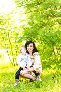 Spring portrait of mother and son on Mother's Day - stock photo