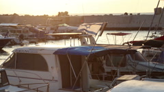 Israel flag fluttering in the wind at anchored yachts. Sunset Stock Footage