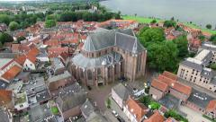 Aerial view of a church near a lake (Harderwijk, The Netherlands) Stock Footage