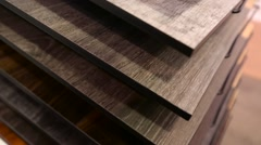 Several layers of parquet stacked in an interior design store - stock footage