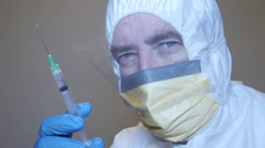 scary doctor medic nurse with syringe vaccine needle - stock footage