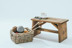 Leisure time, knitting with a cup of coffee - stock photo