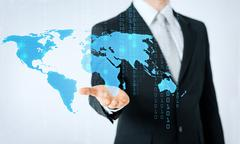 close up of man showing world map and binary code - stock photo
