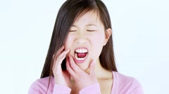 Asian woman with bad teeth problem - stock footage