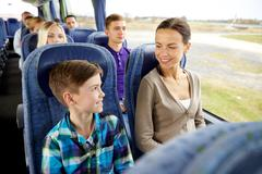 Happy family riding in travel bus Stock Photos