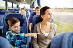 happy family riding in travel bus - stock photo