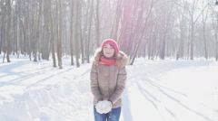 Happy young woman throws snow in park, slowmotion Stock Footage