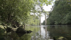 Barge and pedestrians travelling on world famous Pontcysyllte Aqueduct Stock Footage