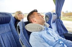 Man sleeping in travel bus with cervical pillow Stock Photos