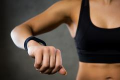 woman with heart-rate watch in gym - stock photo