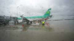 Rain at Munich airport, view from moving bus. Stock Footage