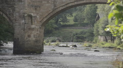 Old Welsh Bridge Over The River Dee Stock Footage