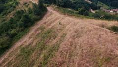 Drone on the side of a hill in the hot season Stock Footage
