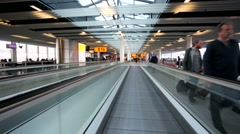 Walking on an travelator at Amsterdam Airport Schiphol. Stock Footage