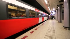 Train at modern underground platform at Airport Schiphol. Stock Footage