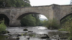 Old Welsh Bridge Over The River Dee - stock footage