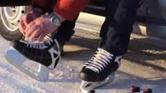 man tightens the laces on the skates - stock footage