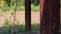 Rusted poles in a field surrounded by green grass (HD) Stock Footage