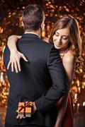 Beautiful couple on glitter gold background - stock photo