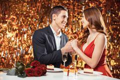 Beautiful couple on glitter gold background Stock Photos