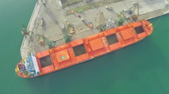 Aerial view, harbor crane are loading corn seeds on ship, DRONE time lapse Stock Footage