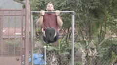 Man doing L-sit chin ups on a bar Stock Footage