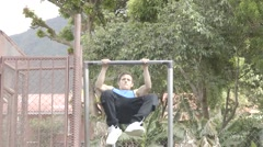 Man doing a muscle up and going into dips on a bar - stock footage