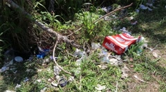 Trash littered on the ground Stock Footage