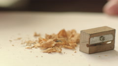 Wooden Sharpener, Graphite Pencil and Shavings - stock footage