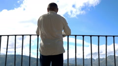 Man admire beautiful landscape from the view point terrace, super slow motion - stock footage