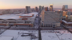 Nashville Snow- City skyline pan over to stadium Stock Footage