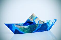 Paper boat made with a world map (furnished by NASA) Stock Photos