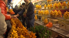 Gold fruit/Solanum Mammosum on sale in canton Flower Market for Chinese New Year - stock footage