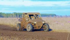 Utv car racing. Mud track. - stock footage
