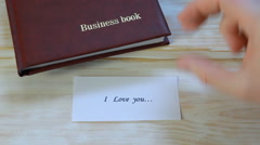 I love you. love letter lying on the table Stock Footage