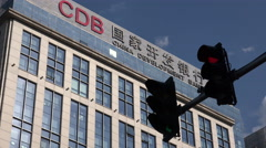 China development bank, red traffic light, economic slowdown, symbolic Stock Footage