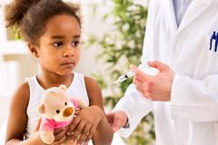 Brave little girl receiving injection - stock photo