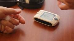 The doctor making a blood test with a new portable test device - stock footage