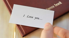 Love letter lying on the table Stock Footage
