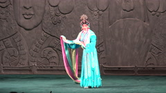 Female Peking opera performer on stage in China - stock footage