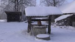 Old well in desolate homestead Stock Footage