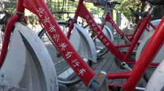 City bikes for rent in the hutongs of Beijing, China Stock Footage